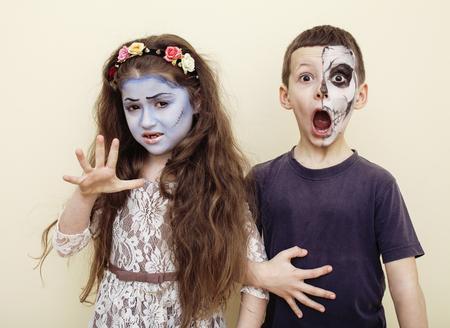 funny boy: zombie apocalypse kids concept. Birthday party celebration facepaint on children dead bride, scar face,  skeleton together having fun