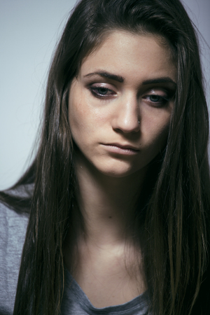 messed: problem depressioned teenage with messed hair and sad face, real junky bad looking girl close up, fooling around Stock Photo