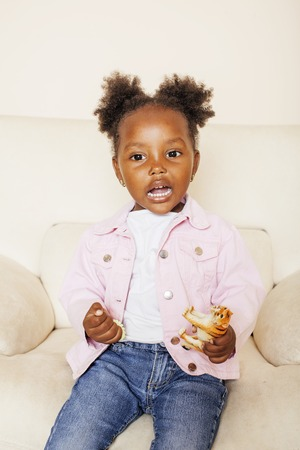 litle: litle cute sweet african-american girl playing happy with toys at home, lifestyle children concept