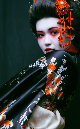 geisha kimono: young pretty geisha in kimono with sakura and decoration