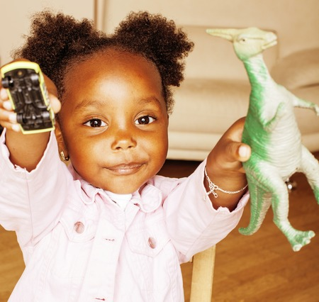 litle: litle cute sweet african-american girl playing happy with toys at home, lifestyle children concept close up smiling
