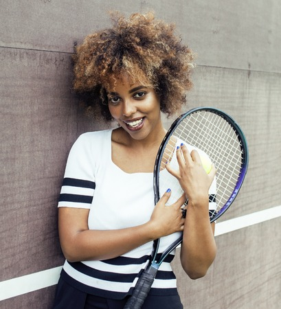 mulatto: young stylish mulatto afro-american girl playing tennis, sport healthy lifestyle people concept