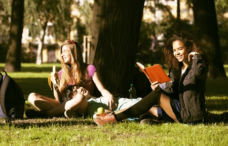 multy: cute group of teenages at the building of university with books huggings, diversity nations, having lunch