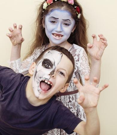 halloween party celebration facepaint on children dead bride scar face skeleton together lifestyle real children concept