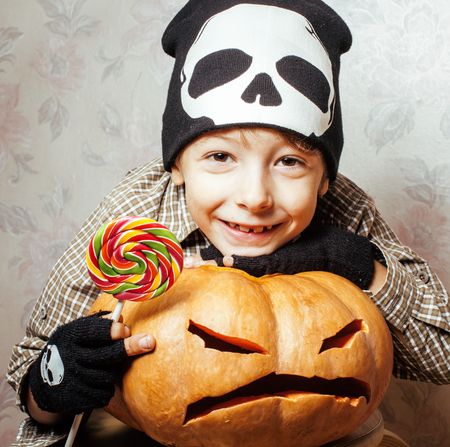 little cute boy with halloween pumpkin close up holding candy, trick or treat smiling happy kid Stock Photo