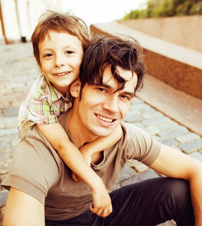 little son with father in city happy hugging close up smiling Stock Photo