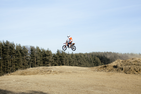 motorsprot: motorcycle jump from springboard outdoor training in forest, lifestyle people concept Stock Photo