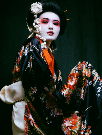 geisha kimono: Young beautiful asian womans portrait, geisha in kimono on black