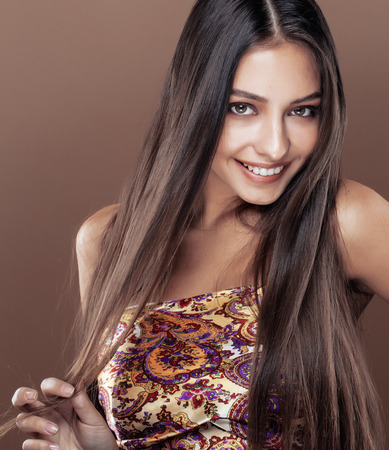 cute happy young indian real woman in studio close up smiling, fashion mulatto adorable Stock Photo