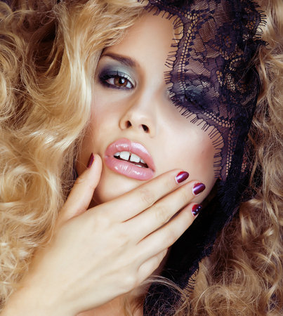 seduction: Portrait of beauty blond young woman through black lace close up sensual seduction concept