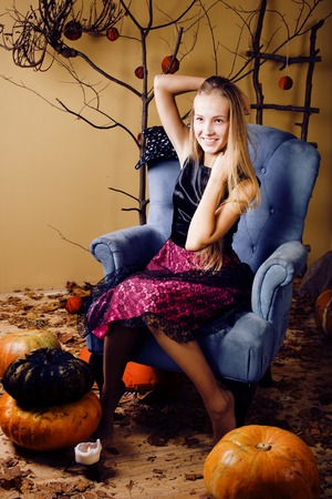 nude little girls: pretty blonde girl selebrating halloween in fairy interior, lifestyle happy smiling people concept close up Stock Photo