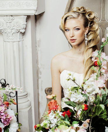 beauty young bride alone in luxury vintage interior with a lot of flowers close up, wedding style Stock Photo