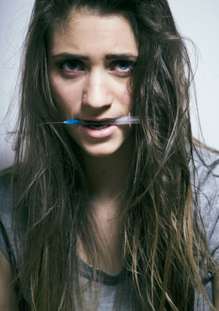 messed: problem depressioned teenage with messed hair and sad face, junky with syringe