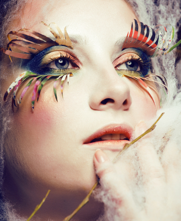 woman with creative make up closeup like butterfly, summer trend big lashes, halloween makeup, holiday real people image concept