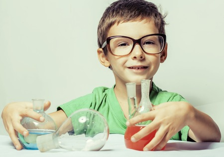 little cute boy with medicine glass isolated wearing glasses smiling, small genious, lifestyle people concept close up