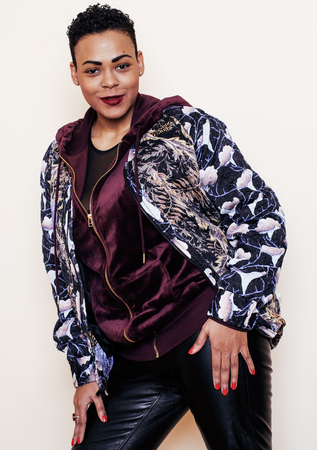 mulatto woman: young pretty mulatto woman with modern haircut fancy dressed, posing smiling, fashion concept, lifestyle people Stock Photo