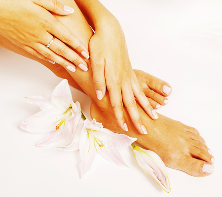 mani: manicure pedicure with flower lily close up isolated on white perfect shape hands spa salon, mani pedi concept