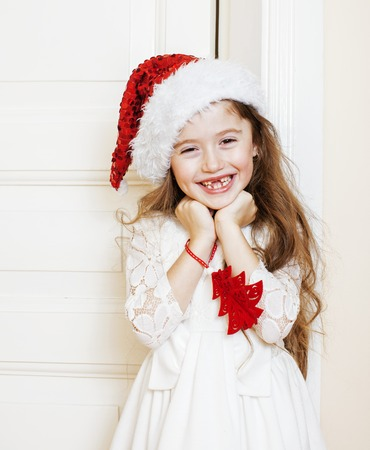 little cute baby girl in santas red hat waiting for christmas gifts smiling adorable kid