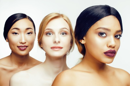 three different nation woman: asian, african-american, caucasian together isolated on white background happy smiling, diverse type on skin, lifestyle people concept close up Stock fotó - 64614584