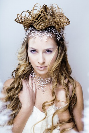 beauty young snow queen in fairy flashes with hair crown on her head Stock Photo