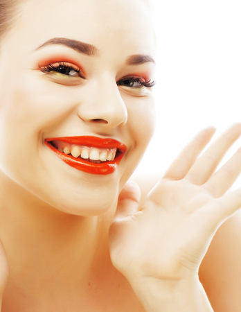 young blond woman with bright make up smiling pointing gesturing emotional isolated like doll lashes on white, lifestyle people concept Stock Photo