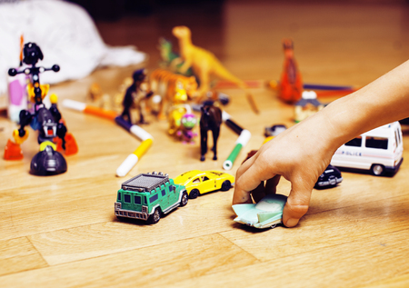 free education: children playing toys on floor at home, little hand in mess, free education, lifestyle people concept