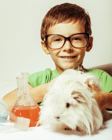 discoverer: little cute boy with medicine glass isolated wearing glasses smiling close up science concept