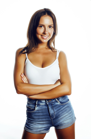 young pretty brunette woman in jeans shorts isolated on white smiling happy, lifestyle people concept close up
