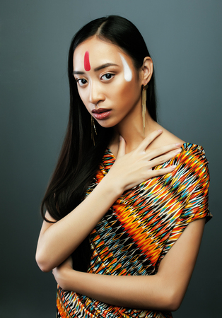 pocahontas: beauty young asian girl with make up like Pocahontas, red indians woman fashion, close up beauty vietnamese
