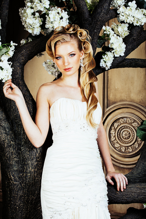 luxe: beauty young woman bride alone in luxury vintage interior with a lot of flowers close up