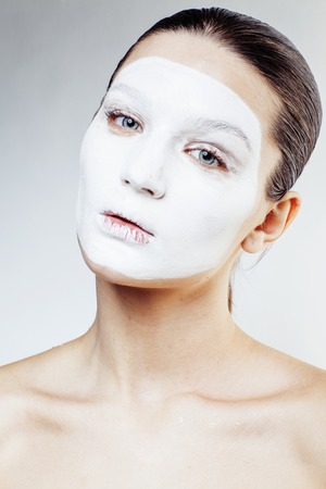 mummery: young pretty woman with facial white mask isolated close up spa, lifestyle real people healthcare concept