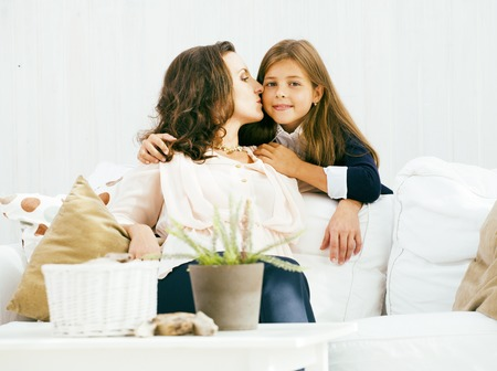 happy smiling mother with little cute daughter at home interior, casual look modern real family, lifestyle people concept close up Stock Photo