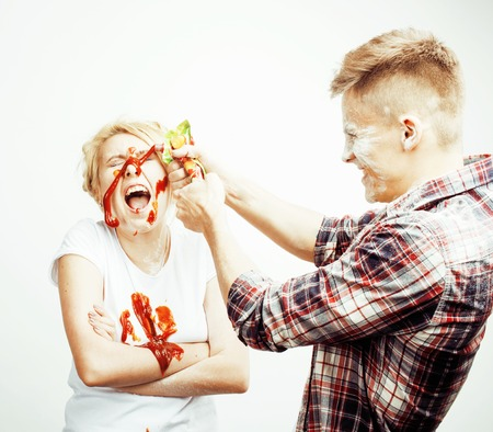 young pretty couple, lifestyle people concept: girlfriend and boyfriend cooking together, having fun, making mess isolated on white background close up