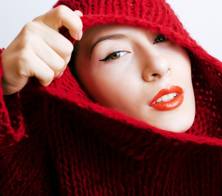 young pretty brunette woman in sweater and scarf all over her face, lifestyle people winter concept Stock Photo