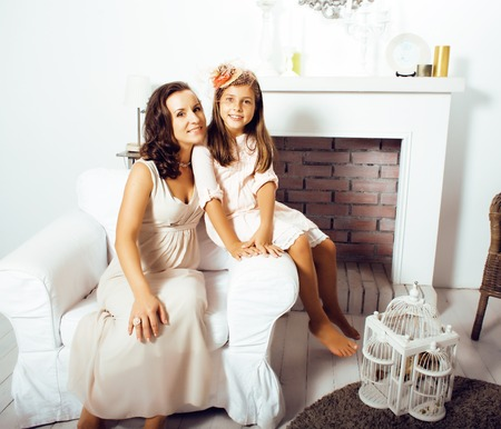 aciculum: happy smiling mother with little cute daughter at home interior, lifestyle people concept close up