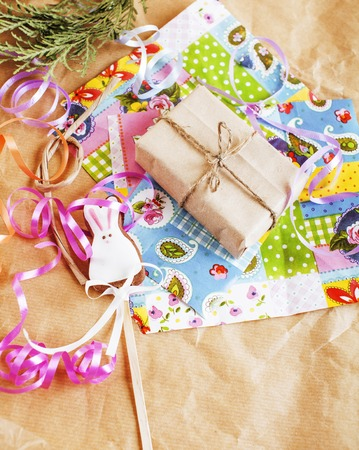 lot of stuff for handmade gifts, scissors, ribbon, paper with countryside pattern, ready for holiday concept, nobody home close up Stock Photo