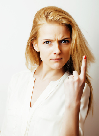 white backgroung: young blond woman on white backgroung smiling gesture thumbs up, isolated emotional posing close up, lifestyle people concept