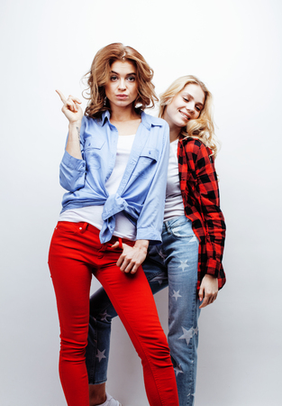 jeune fille adolescente: two pretty blond woman having fun together on white background, mature mother and young teenage daughter, lifestyle people concept Banque d'images