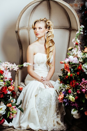 beauty young bride alone in luxury vintage interior with a lot of flowers close up Stock Photo