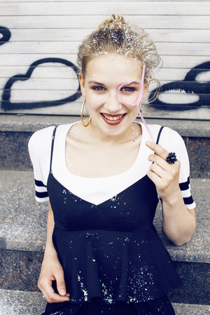 fas: young pretty party girl smiling covered with glitter tinsel, fas