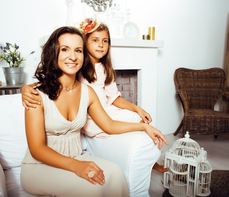 aciculum: happy smiling mother with little cute daughter at home interior, lifestyle people concept