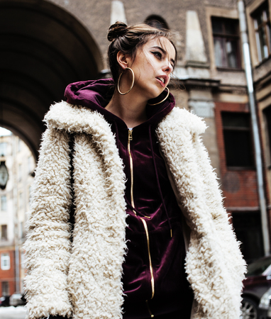 junky: young pretty stylish teenage girl outside at city wall with graf Stock Photo