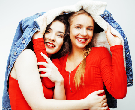 messed: lifestyle and people concept: Fashion portrait of two stylish sexy girls best friends, over white background. Happy time for fun.