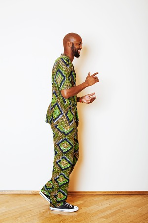 portrait of young handsome african man wearing bright green nati Stock Photo