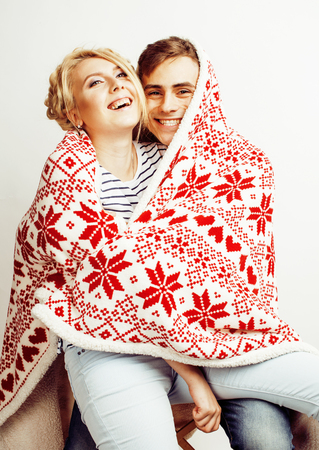 young pretty teenage couple, hipster guy with his girlfriend happy smiling and hugging isolated on white background, lifestyle people concept, valentine design winter plaid