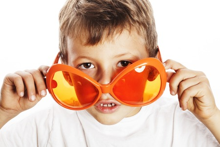 little cute boy in orange sunglasses pointing isolated close up Stock Photo