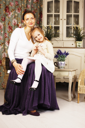 young mother with daughter at luxury home interior vintage Stock Photo