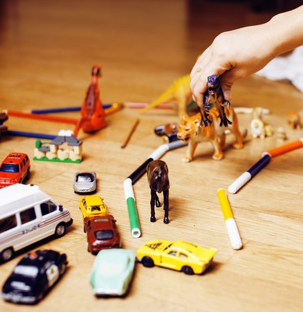 mess: children playing toys on floor at home, little hand in mess, free education