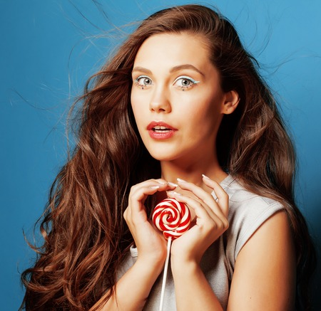 young pretty adorable woman with candy close up like doll Stock Photo
