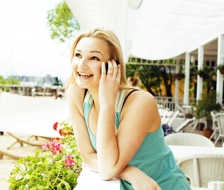 portrait of pretty modern girl friend in cafe open air interior